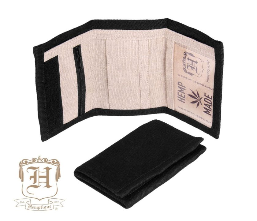 Hemptique hemp wallet in black color unfolded and laying on its side, with another wallet folded up in front of it